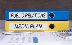 Public Relations and Media Plan. Binders in the Office stock photo