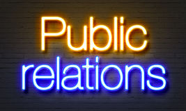 Public relations neon sign on brick wall background. Public relations neon sign on brick wall background stock photo