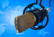 Public relations PR microphone for news global map world press. Photo royalty free stock images