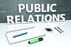 Public Relations. Text concept with chalkboard, notebook, pens and mobile phone. 3D render illustration Royalty Free Stock Photography