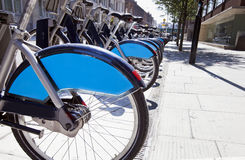 Public Rental Bicycles in a Line, London, UK Royalty Free Stock Photos