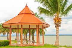 Public rest-house. Oriental mediation stand on the middle of an public garden lake stock image