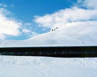 A public restaurant in the snow covered mountain in St Moritz Switzerland.  Stock Photo
