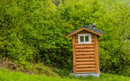 Public restroom built to look like a small log cabin Royalty Free Stock Photography
