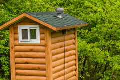 Public restroom built to look like a small log cabin Royalty Free Stock Images