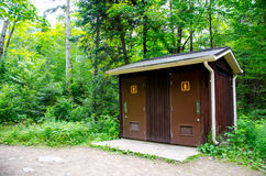 Public Restroom in the forest Royalty Free Stock Photo