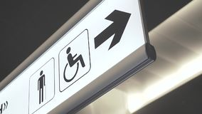 Public Restroom Signs. Public restroom illuminated signs with a disabled access symbol in the airport. Graphic design in public place stock video