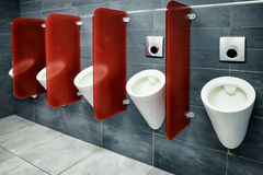 Public restroom. Modern public restroom - row of urinals Stock Photo