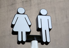 Public restroom sign. A public restroom sign background stock photography