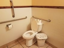 Public restroom with toilet and bars. Public restroom with toilet, trashcan, and bars Stock Photography