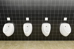A public restroom with urinals row Royalty Free Stock Photos