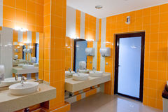 Public restroom with washstands mirror Stock Images
