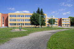 Public school. Exterior view of school building whith playground Royalty Free Stock Photos