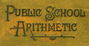 Public School Arithmetic. Old lettering on the cover of a Public School Arithmetic book Stock Image