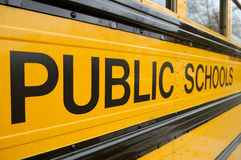Public School Bus. Detail, black text on yellow background Royalty Free Stock Image