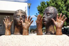 Public sculpture of hands and heads Stock Image