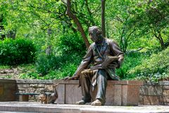 Public sculpture of Hans Christian Andersen in the Central Park, NYC. New York, USA - May 8, 2018 : Public sculpture of Hans Christian Andersen in the Central Stock Image