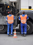 Public sewerage servicing. Professional urban public sewerage servicing team in action Royalty Free Stock Images