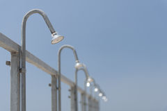 Public shower heads. On the beach against blue sky Royalty Free Stock Images
