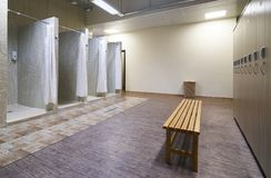 Public shower interior with everal showers. And lockers in locker room in luxury fitness spa centre Stock Image