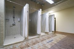 Public shower interior with everal showers. And lockers in locker room in luxury fitness spa centre Stock Photo