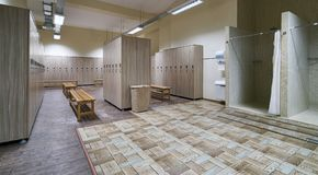 Public shower interior with everal showers. Toilet sink and lockers in locker room in luxury fitness spa centre Stock Image