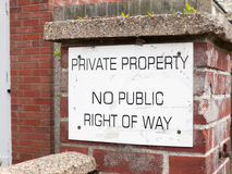 A public sign outside on a brick wall saying private property no Royalty Free Stock Images