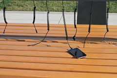 Public solar powered mobile phone charger. Innovative technology , using energy of sun for changing mobile phone Royalty Free Stock Images