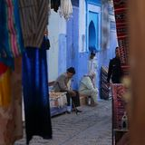 Comercial street, life on the street. Public space on a comercial street in medina in Chefchaouen or Chaouen, carpet sellers and social life in the old city Stock Images
