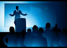 Public Speaker. A businessman delivering a speech Stock Photo
