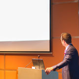 Public speaker at Business Conference. Royalty Free Stock Image