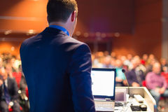 Public speaker at Business Conference. Speaker at Business Conference with Public Presentations. Audience at the conference hall. Entrepreneurship club Royalty Free Stock Photos