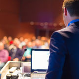 Public speaker at Business Conference. Stock Image