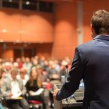 Public speaker giving talk at Business Event. stock photography