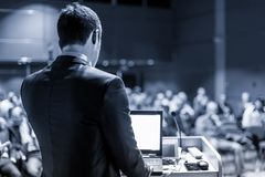 Public speaker giving talk at business event. stock photos