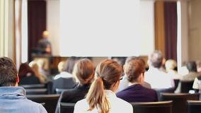 Public speaker giving talk at business event. stock footage