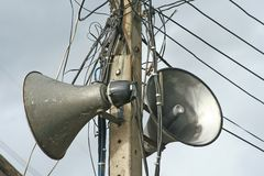 Public speaker on low voltage power pole royalty free stock photography