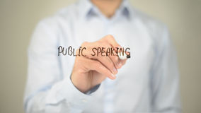 Public Speaking , Man writing on transparent screen. High quality royalty free stock photography