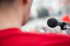 Public speech. Political concept, focus point on black mic and lens blur f/x royalty free stock photography
