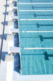 Public Sports pool with starter blocks and swimming corridors Stock Image
