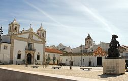 Public square in Faro, Portugal. Churches in view under a blue sky Royalty Free Stock Images
