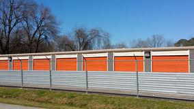 Public storage facilities. Colourful public stores against blue winter background Stock Photos