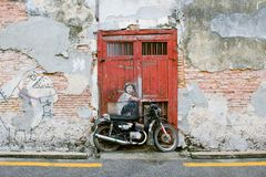 Famous Street Art Mural in George Town, Penang Unesco Heritage Site, Malaysia. Public street art Boy on a Bike on the wall by Lithuanian artist Ernest Zacharevic Stock Photography