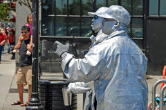 Public street live statue artist Stock Photos
