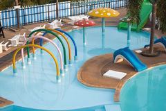 Public swimming pool and water park. Kids play Stock Photo