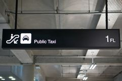 Public taxi information board sign at international airport. Public taxi information board sign with white character on black background at international airport Stock Photo