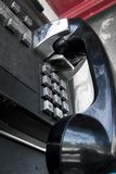 Public Telephone. Black and Silnver public telephone from low angle Stock Photos