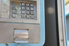 Public telephone booth keypad royalty free stock photography