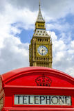 Public telephone sign in front of the Big Ben Royalty Free Stock Photography