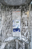 Public Telephone Vandalized with White Paint Stock Photo
